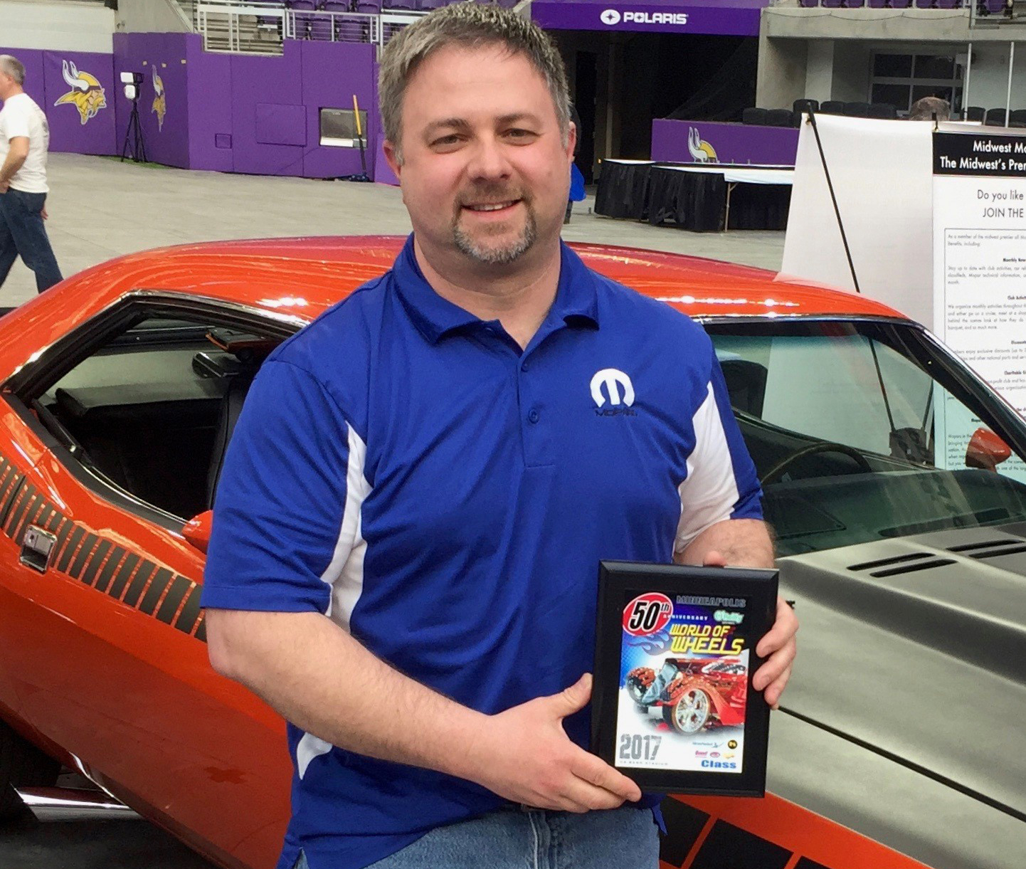 Jake Mayne poses with an award he won for his 1970 Plymouth AAR Cuda.