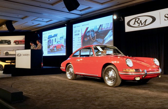 Porsches parade at Werks Reunion, Amelia auction blocks