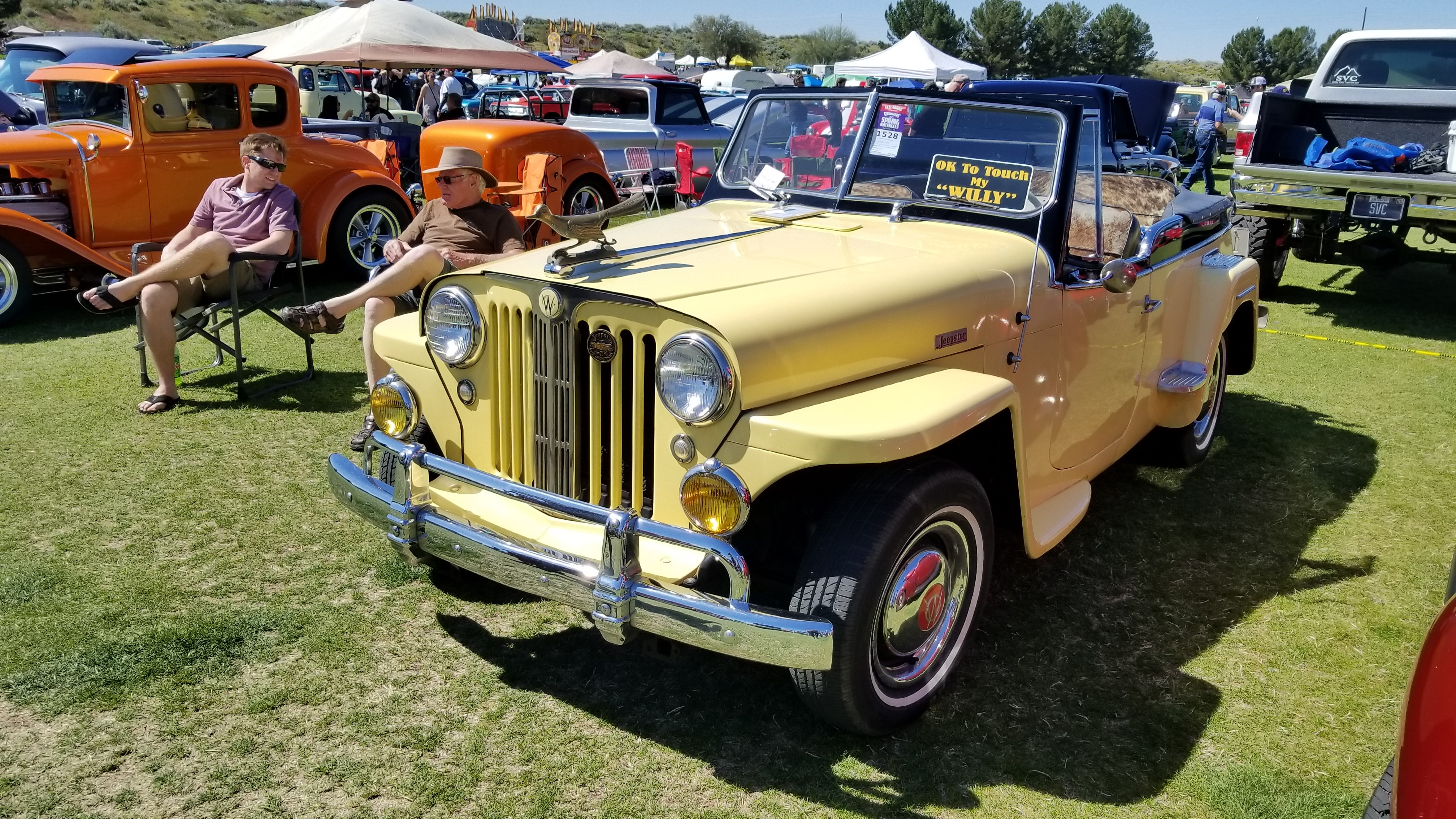 This 1949 Willys Jeepster is nearly all-original, save for a paint job, the crazy roadrunner hod ornament and the longhorn hide interior. | Rebecca Nguyen photo