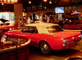 A bar with cars, and lots of them