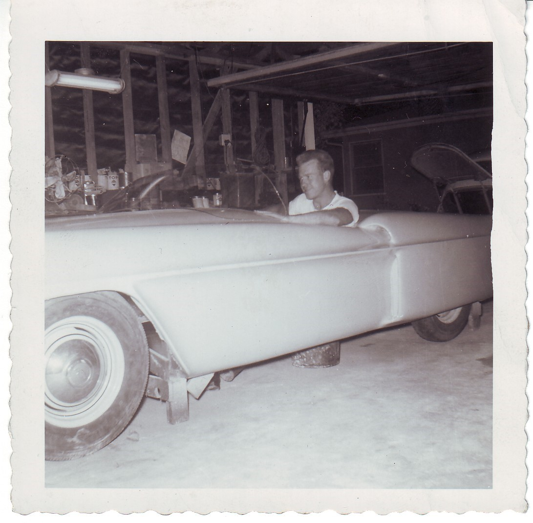 A Hansen brother sits in one of the unfinished Cobras.