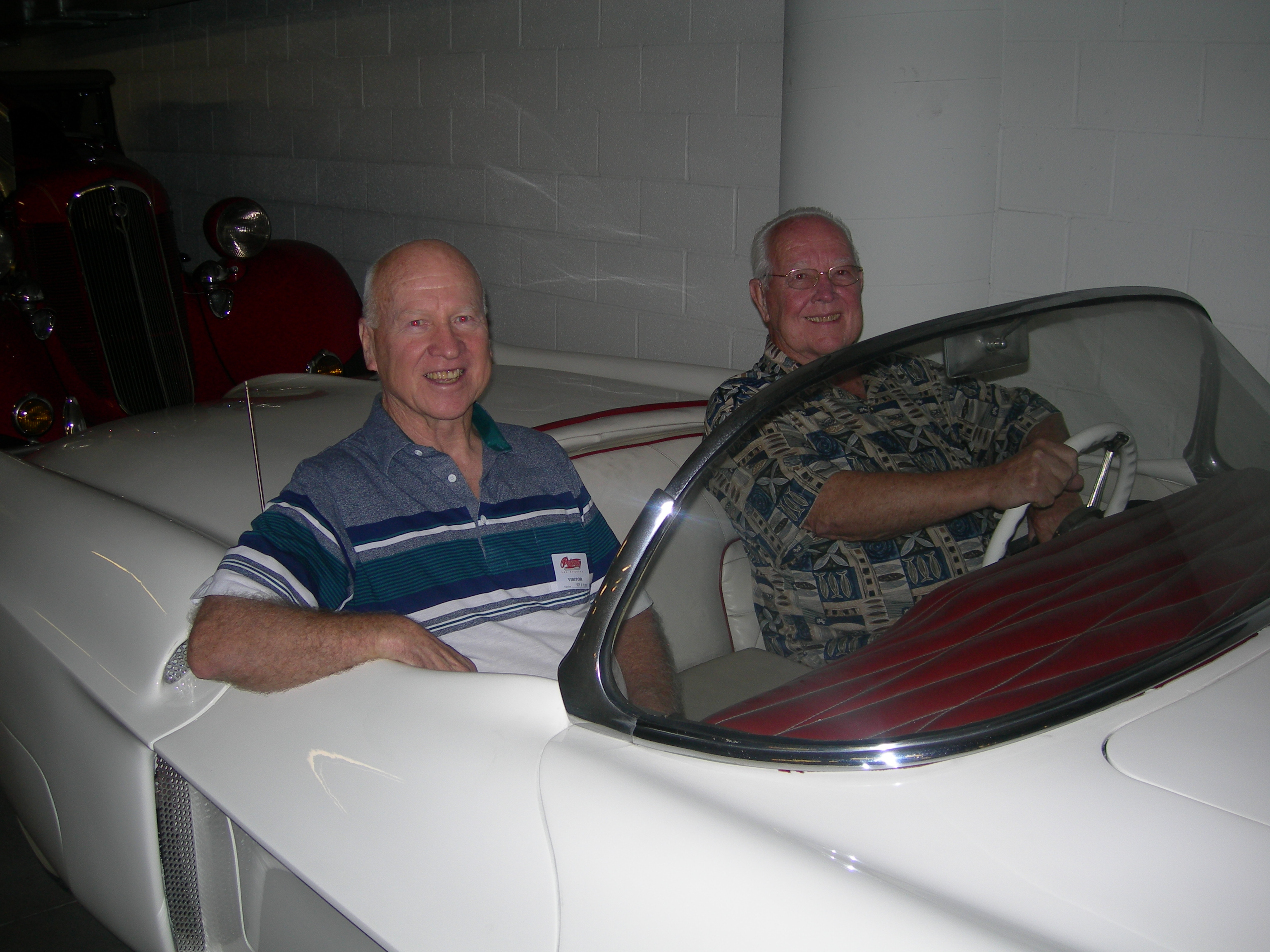 The Hansen brothers sit in one of the cars they crafted.