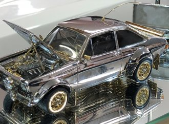Scale-model Ford Escort made of gold, silver and gems