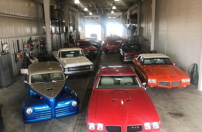 Classics cross auction block along with heavy equipment vehicles