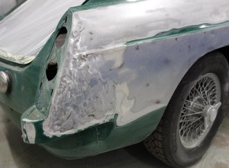Sanding reveals another blemish as the MGB GT restoration stalls