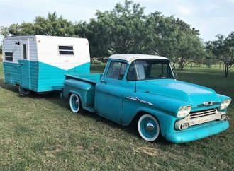 Vintage Chevy pickup with camper ready to hit the open road