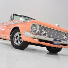 Not pink. Not orange. Not even salmon. But it is a 1962 Plymouth Sport Fury convertible