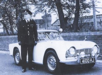 Police-owned Triumph TR4 brings $43,000 at auction