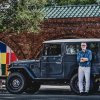 Men's fashion designer styles an FJ43 Land Cruiser