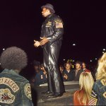 Big Willie-1974-on truck in East LA instructing the Brotherhood of the street racing rules-str 014-Howard Koby photo