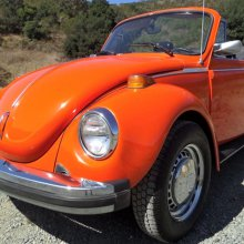 Top-down classic, 1974 VW Beetle convertible in bright orange