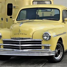 This '49 Plymouth coupe pulls along a camp trailer