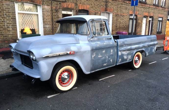 '59 Chevy pickup undergoing restoration, right on a street in London
